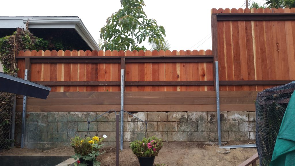 Custom Floating Wood Fence atop Floating Wood Retaining Wall Extension, while Reinforcing old Concrete Block Retaining Wall, Los Angeles 90056, built by WoodFenceExpert.com