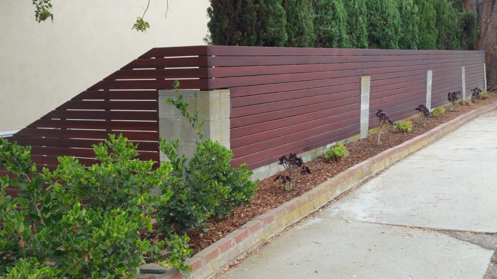 Custom Horizontal Wood Fence Atop Existing Old Concrete Block Replacing Steel Rusted Inserts