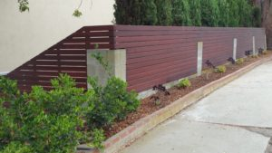 Custom Horizontal Wood Fence atop Existing old Concrete Block (replacing old steel rusted fence inserts), Los Angeles 90056, built by WoodFenceExpert.com